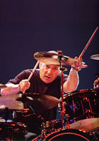 Hudson Music has announced the October release of a groundbreaking new 3-dvd set from Neil Peart of Rush, one of the true living legends of drumming. In 'Taking Center Stage: A Lifetime of Live Performance', Neil examines the details and challenges of per